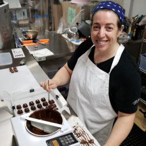 Iris marking chocolates in the kitchen